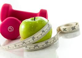 apple with tape measure and weights