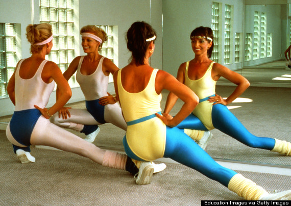 1980'S, Two Women In Workout Clothes Doing Aerobics.