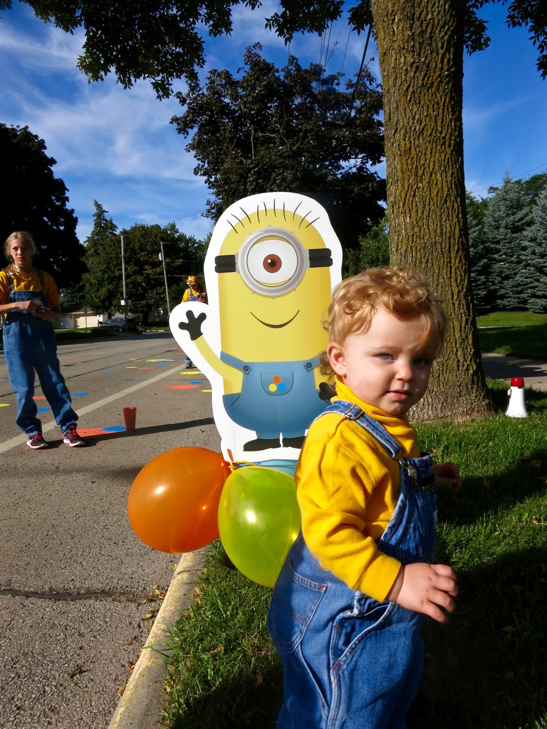 child next to minion cutout
